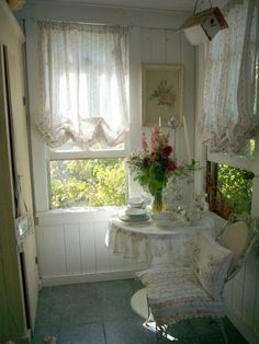 lovely spot to read or crochet ♥❤♥ nice look for birdroom  I want my vintage camper to look something like this.