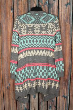 Shop The Texas Cowgirl for our Gray & Mint Aztec Tribal Cardigan. This medium weight cardigan is perfect for mild winter days. Free shipping in the USA.
