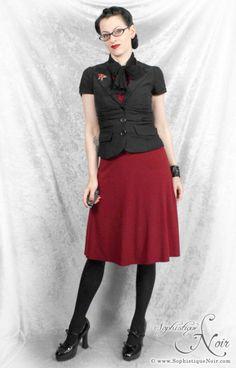 Professional attire; black blazer, red skirt/colored skirt, short sleeve blazer, black tights