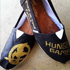 custom toms hunger game shoes Hand-painted on toms shoes. $59.99, via Etsy.