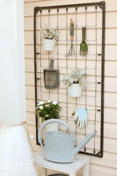 Baby crib spring mounted to the wall.