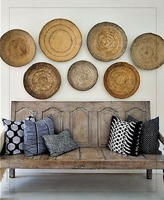 """love the """"door"""" bench and woven baskets."""