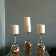 DIY candle holders will look good at any party! Wine bottle corks and wine goblets... how easy is that?