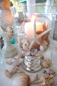 seashell bouquet Beach themed table setting with shell candle as wedding centerp. [ seashell bouquet Beach themed table setting with shell candle as wedding centerpiece.