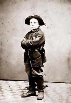 Child Soldier. During the Civil War, children as young as 6 or 7 years old would enlist. This boy is wearing a uniform. It appears that he is a combat soldier, not a drummer boy, in that he is wearing a Colt Revolver.