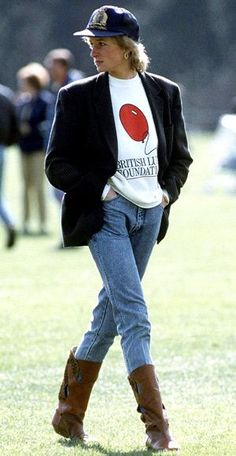 1988         Proving that she needed little more than her statuesque frame to make an impression, she strolled the grounds at the Guards Polo Club in jeans and a sweatshirt topped by a crisp blazer.