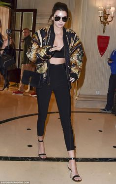 Working it: Make-up free model Kendall Jenner was pictured leaving her hotel on Thursday as she made her way to the Balmain fashion show in Paris