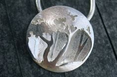 Helen O'Dea. Silver Trees pendant, hollow bead. Use the wooden block to make it concave and cut things out and solder them together!!!
