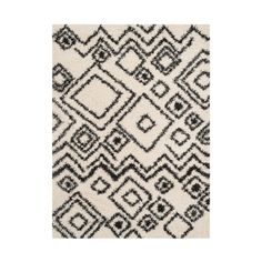 Sink your toes into the plush luxury of this easy-care shag rug. It combines neutral charcoal and ivory into intriguing, free-form geometric shapes.