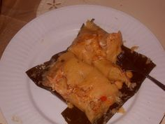 Tamales are typically a type of hmmm you could consider it a steamed meat pie or something of that sort, a starchy dough typically made of ...