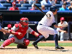 New York Yankees center fielder Brett Gardner (11) hits a RBI single against the Phillies in the fourth inning at Yankee Stadium. (Andy Marlin/USA Today)