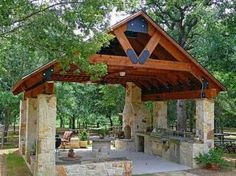 Want an open stone entertaining pavilion next to pool, with fireplace, outdoor kitchen, changing and bathroom - Norris Architecture