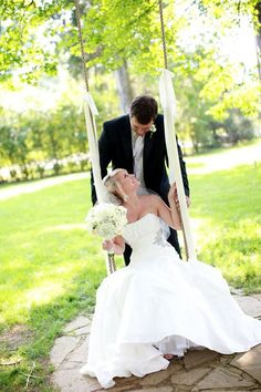 bride and groom on swing- I wanted a picture like this SO bad whenever I was getting married... didn't happen.