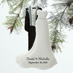 LOVE LOVE LOVE this personalized bride and groom wedding ornament! I love the sparkle at the bottom! This is such a great wedding gift idea or christmas gift idea for newlyweds - you can have it engraved with the couple's names and wedding date! LOVE IT!