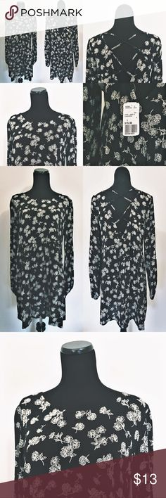 Forever 21 Black and White Floral Print Dress Forever 21 Black and White Floral Print Dress. Super cute and lightweight. Very 90s, Drew Barrymore, flower power child. New with tags. Never worn. 100% Rayon. Extremely comfortable and loose fitting. Size L, but would work for a M too. Forever 21 Dresses Long Sleeve