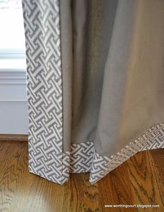 buy plain pre-made drapes and install a band of the striped material in a herringbone pattern.