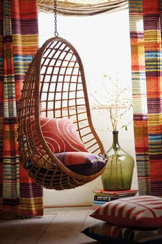 Bamboo vintage chair hangs from any strong chain or rope with a hand-forged hook, cradling you for a quiet Zen moment, indoors or outdoors.  Cool for teen's room, or even cooler for your living room.