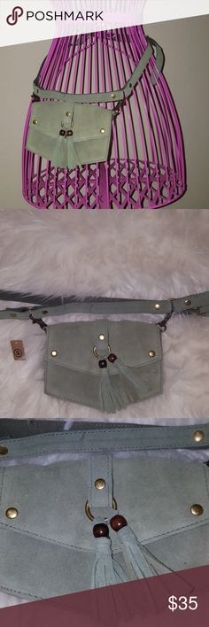 Are you Coachella ready? Beautiful military green belt purse  Earthbound trading co has wonderful products this one is just one!  70% leather 30% cotton  Adjustable waist band  I love the smell of leather! This one is a must have! earthbound trading co Bags