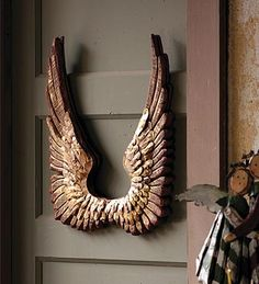 I have a thing for angel wings. This wooden pair is pretty sweet (for my artist studio I one day intend to have).