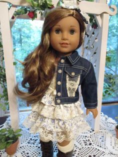 This denim and lace 5-pc jacket and knit dress set will give your doll a summery ensemble with southwestern flair that can carry into fall! With lots of detailing throughout, it includes: * Fully lined cotton knit mini dress in pretty blue florals on a cream backdrop has tiers of ruffles with lace, short, lace-edged sleeves, and a lace and ribbon trimmed bodice. It closes in back with thin velcro. * Denim jacket is made of a lightweight denim thats perfect for doll clothing, is top stitched…