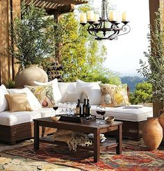 Warm outdoor living space-Pottery Barn  Love those pillows!