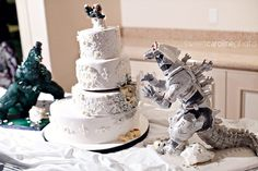 Best wedding cake ever! No I didn't make it, nor did I take the photo. I stumbled across it while looking for a Godzilla cake. Although the got Godzilla's color wrong!! he is gray people not green!! Btw the photo is by Temple Wedding Photography and the cake is by Coco Paloma.