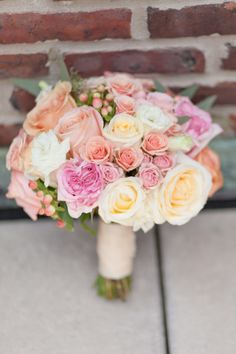 Multi-color rose bouquet: http://www.stylemepretty.com/new-york-weddings/new-york-city/manhattan/upper-east-side/2014/04/04/classic-nyc-museum-wedding/ | Photography: Jamie Lefkowitz - http://jamielefkowitzphotography.weebly.com/