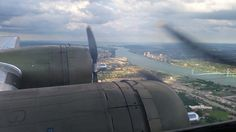 B-17 flying over Detroit skyline & Ambassador Bridge