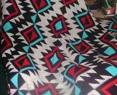 """Niki Porter made this beautiful afghan & submitted to her state fair.  It was the 1st time she had ever submitted a work to a state fair and she won a blue ribbon for it!  """"The pattern for it is located in the book """"Herrshners Blue Ribbon Afghans"""", page 46, titled """"Artful Aztec."""" Took nearly 2 yrs & 13 skeins of yarn to complete"""