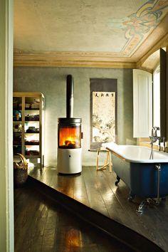 Stub by Emo design , via Behance. Always interested in indoor wood stove heating.