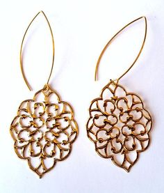 The new bohemian earrings inspired by the colorful spirit of the 70's. Feel free in this high style marquise earwire with Spanish inflected earring pendant. Beautiful filigree details. Lightweight and