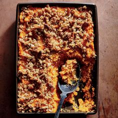 Sweet Potato Casserole with Crunchy Oat Topping | This classic casserole straddles the line between side and dessert (indeed, we've enjoyed the leftovers both ways). We dial down the sugar to steer the dish back to savory territory, and add a crunchy oat and nut topper for texture. A final drizzle of maple syrup just before serving gives the casserole a lovely sheen. While we call for a ricer in our master mashed potatoes, a potato masher is perfectly acceptable here since the spuds will be