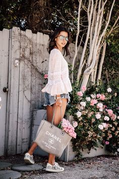 Casual summer day - wearing a cute casual outfit for a day of running errands - long sleeve blouse, denim shorts, sneakers, and a Chanel tote filled with flowers Style Outfits, Casual Summer Outfits, New Outfits, Chanel Tote, Shopper Bag, Chanel Canvas, Look Con Short, Viva Luxury, Chanel Handbags