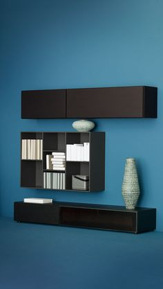 Do you want to show your treasures or hide your secrets? Or even do both at the same time? We're sure that we have just the right wall system for you. Hallway Storage, Hallway Furniture, Boconcept, Hallway Decorating, Cool Walls, Decorative Objects, Modern Wall, Floating Shelves, Furniture Design