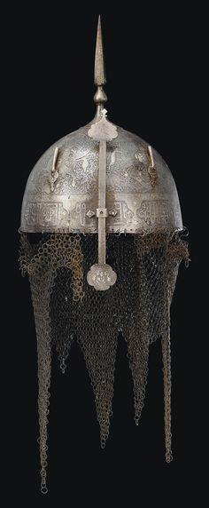 A QAJAR SILVER-OVERLAID STEEL HELMET IRAN, 19TH CENTURY