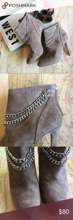 """Dolce Vita chain suede booties Dolce Vita   Luxe suede booties in a rich taupe with silver chain detail. These modern and edgy booties feature a rounded toe and back zip closure. Make a statement by pairing them with moto pants or a black leather mini! Never worn; in excellent, like new condition.   Size: 7.5 Heel height: 4.5"""" Shaft height: 4.5""""   [All photos shown are my own and may not be used] Dolce Vita Shoes Ankle Boots & Booties"""