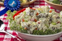 This creamy potato salad is loaded with eggs, red bell pepper, and celery. It looks just as good as it tastes!