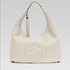 Gucci hobo bag ! Ivory colour Gucci hobo bag , never used . Has the Gucci authenticity card as shown in the picture . Gucci Bags Hobos