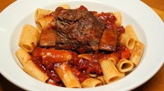 Fall-off-the-bone short ribs in a well-seasoned sauce over pasta make a sensational meal. Ingredients 8-10 bone-in beef short ribs, trimmed of fat Salt and pepper 4 tablespoons extra virgin olive oil (EVOO) 2 carrots, finely diced 2 ribs celery, finely diced 1 large onion, finely diced 4 large cloves garlic, thinly sliced 2 large fresh …