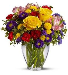 Brighten Your Day-With an abundant array of bright red, yellow and purple flowers, this arrangement is sure to brighten your day. #CarlsonWildwoodFlorist #LargoFlowers #GetWellFlowers