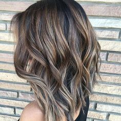 I think I see gray strands mixed in with this brown with blonde highlighted hair.