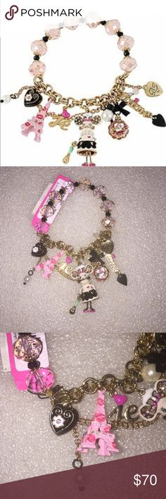 Betsey Johnson bracelet Seller bf to buy betsey pieces I need. This is from the Paris collection. The bracelet is stretch. The bracelet is made of beads, mouse, Eiffel Tower, heart and among more. Super rare. NWT Betsey Johnson Jewelry Bracelets