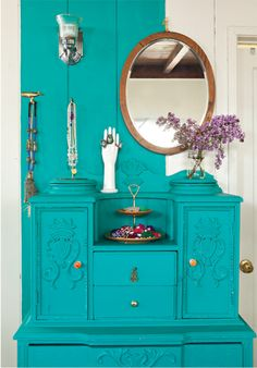 I painted this dresser in turquoise and then painted the wall behind it to match, creating the look and feel of a built-in.