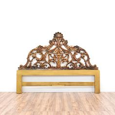 """This """"Henredon"""" rococo style headboard is featured in a solid wood with a shiny antiqued gold finish. This king sized headboard has a curved top and intricate carved floral and acanthus leaf accents. Eye catching piece perfect for adding elegance to a bedroom! #bohemian #beds #headboard #sandiegovintage #vintagefurniture"""
