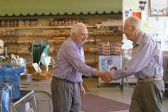 Wilmore grocery store owner Leonard Fitch, left, greeted longtime customer Harry Stevenson as business continued as usual Saturday at Fitch's IGA while a group of volunteers pitched in to refurbish the store in hopes of preventing it from closing.