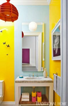 Colorful powder room by Timothy Brown! Blue wall covering is Delfo/Pale Blue; yellow is Delfo/Sun by Stark! Love the colorful toilet tissue!!
