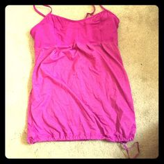 Lululemon tank top  Gently worn Lululemon pink tank. Gathers at bottom. No rips/stains/smoke free home. Great condition! lululemon athletica Tops Tank Tops