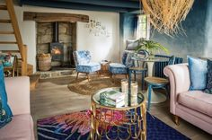 LOOK AT THIS GRADIENT WALL!!! Rest of the cottage is lovely too! Luxury bohemian hideaway cottage in Coverack Cove, Cornwall is bursting with colour http://www.countryliving.co.uk/homes-interiors/property/news/a882/bohemian-siren-cottage-cornwall/