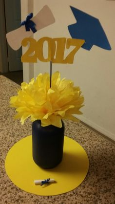 How to Make DIY Graduation Party Decorations and Centerpieces Graduation centerpiece Graduation Table Centerpieces, Graduation Decorations, Candle Centerpieces, Wedding Centerpieces, Graduation Party Planning, Graduation Diy, Graduation Parties, Class Reunion Decorations, Thanksgiving Crafts For Kids