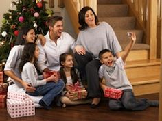 Every year, many families like to take a Christmas photo with their family. Whether they use this photo for their Christmas cards, to place in their scrapbook, or to frame and hang on the wall, it can be challenging to come up with the right outfits to wear, the right location to have the picture taken, and how to differentiate it from past Christmas photos. Have no fear, Christmas photo pose ideas are here.